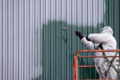 Photo about A commercial painter on an industrial lift spray painting a steel exterior wall or duct. Design Jobs, Industrial Paintings, Local Painters, Commercial Roofing, Remodeling Companies, Painting Contractors, Union City, Best Commercials, Painting Services
