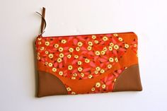 Perfect for stashing your boarding pass, copies of your passport, and other travel documents.    Leather Trimmed Zip Pouch. $30.00, via Etsy.