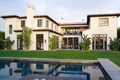 Photos courtesy Meridith Baer & AssociatesExterior of a new construction Spanish revival style home in...