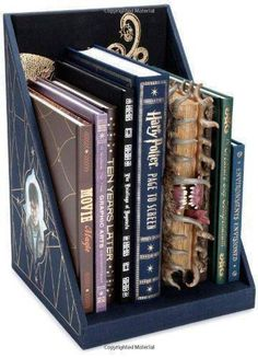 WOW! Harry Potter Page to Screen: The Complete Filmmaking Journey Collector's Edition contains EIGHT books including a prop replica of The Monster Book of Monsters! It is pretty amazing (and pretty expensive, LOL.) Learn more about it on Amazon by clicking on the picture. Perfect gift idea for someone who grew up with Harry Potter. #harrypotter #bookset