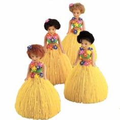 "Mini cakes and mini doll picks put these Hula Dancers in a class by themselves. Make ahead drop flowers and easy-to-ice ""grass"" skirts get you out of the kitchen and onto the dance floor in just a few shakes!"