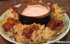 Grilled Onion Bacon Cheese Buds from the BBQ Pit Boys ... This is one of the best grilled onion recipes out there! Tastes even better than Outback's Blooming Onion dish!