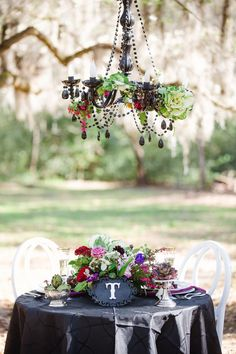 Love this Sweetheart Table look- especially the dramatic floral chandelier!