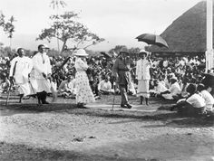 Colonel Robert Tate, New Zealand's second resident commissioner for Samoa, speaks to an outdoor meeting while protected by a sun umbrella, about 1920. He held absolute authority in Western Samoa as the Fono of Faipule, an advisory body of Samoan leaders, was not legally recognised until Tate's departure in 1923. Referring to the Mau movement for Samoan independence, Tate told the governor of American Samoa that much of the unrest was due to ideas of racial equality.