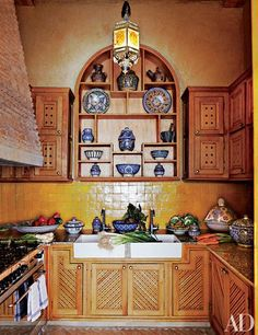 A double farmhouse sink acts as a focal point in this classic Moroccan kitchen. For more kitchens with farmhouse sinks, read on.