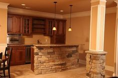 basement ideas. I like the brick around the beam! It makes it cozy looking.