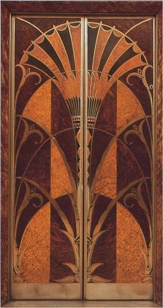 The lobby of the Chrysler Building is entirely lined in amber-coloured marble with lustrous metallic fittings. This is an elevator door with a design based on the papyrus flower, another Egyptian motif. It's executed in inlaid wood and metal.
