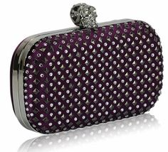 """Stud Clutch Bag With Crystal-Encrusted Skull Clasp           Size: 6.5"""" Wide x 3.75"""" High.      Slightly padded soft to the touch.      Long chain included."""