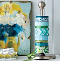 Don't let your favorite ribbon fall off of its roll and get tangled before you get a chance to use it. A paper towel holder can hold your entire collection, and lets you put the pretty patterns on full display. See more at Style at Home »