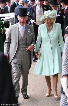 Enjoying their day: The Prince of Wales and the Duchess of Cornwall appeared to be enjoying their day as they strolled through the racecourse