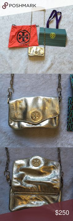 Tory burch silver crossbody mini bag  Tory burch purse  Silver  Gently used clean interior  Please ask for additional pictures, measurements, or ask questions before purchase. No trades or other apps Ships next business day, unless noted in my closet  Five star rating Bundle for discount Tory Burch Bags Mini Bags
