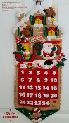 Finished Bucilla Advent Calendar Kit entitled Santa's Toy Shop. Picture sent to MerryStockings.: