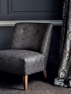 Chair upholstered in Crocodillas, black by Jane Churchill