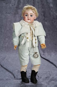 """18"""" (46 cm.) Bisque Character, 143, by Kestner with Costume, Original Wig and Body 400/600"""