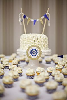 cake. love the sparkle blue and gold pennant plus motto.