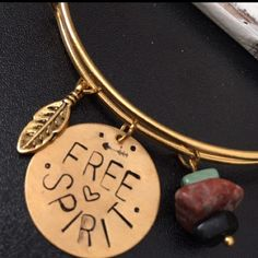 🎉HP🎉PM Editor Pick🎉🍂FREE SPIRIT🍂Custom Bangle 🍂Free Spirit🍂 Custom hand stamped good tone disk bangle!   Feather charm & faux black & turquoise & jasper stones on a dangle for added flair‼️ 🎁Comes  wrapped for the perfect gift🎁 SpiritSnaks Jewelry Bracelets