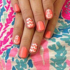 Coral and white chevron manicure