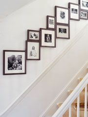 """For my staircase;) A new take on a staircase wall gallery: """"Lining a staircase with family photos is a classic tactic, but you can really give them impact by making a tight arrangement in frames of the same style and color, in three or four sizes. Stairway Photos, Stairway Gallery, Staircase Pictures, Gallery Walls, Stair Gallery Wall, Stairway Art, Gallery Frames, Photo Arrangements On Wall, Display Family Photos"""