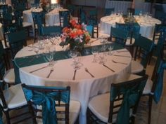 our white tablecloths with satin jade runners and chair sashes