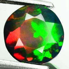 1.47 ct round shape smoked multi color play opal ethiopia 1$