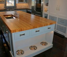 Kitchen Island with Dog Feeding area  What a great idea!  No more kicking the bowls. This will be in my future home!