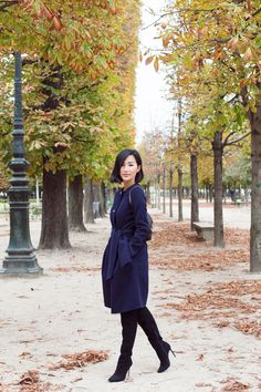 Gary Pepper Girl wearing #CHCarolinaHerrera navy blue wool coat and over-the-knee black suede boots from Fall '14