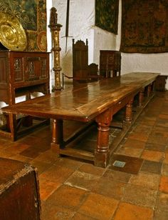 A massive early 17th century Oak Refectory Table raised on ten plain turned legs united by stretchers. Ex. Leeds Castle.
