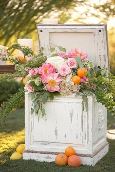 Rustic box designed with trailing flowers and foliages accented with citrus fruit #ElChorro in Paradise Valley, AZ with #AmyandJordanPhotography and #ImoniEvents www.flowerstudioaz.com