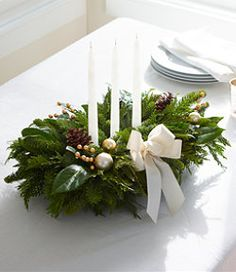 #LLBean: Winter White Holiday Fir Centerpiece Fresh fragrant noble red fir, western red cedar and laurel greens. Trimmed with real pinecones, golden berry sprays and gold and ivory holiday balls. Includes three ivory-colored candles and an ivory grosgrain ribbon. Floral-foam block is easy to water and helps keep fir fresh throughout the holiday season.