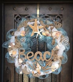 This has been sold but, i like the idea! - This large wreath is 30 diameter and is packed full of charm by using deco mesh and burlap ribbon. It is embellished with several shells of Beach Themed Crafts, Beach Crafts, Diy Crafts, Christmas Crafts, Christmas Decorations, Beach Christmas, Coastal Christmas, Wedding Decorations, Deco Marine