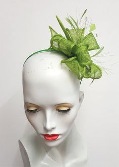 Greenery green sinamay and feather fascinator on by SHMillinery