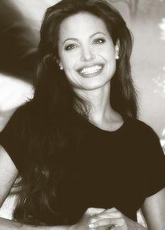 Angelina Jolie absolutely amazing smile. :)