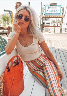 Striped pants and a tan short sleeve crop top/ Visit Daily Dress Me at dailydressme.com for more inspiration