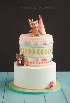 Special woodland tribal baby shower. With native bear, squirrel and teepee. Cutout fondant design on top tier with hand painted herringbone design on bottom tier. Light teal, blue, greens and pinks. Cakes 2014 - My Behance Portfolio: