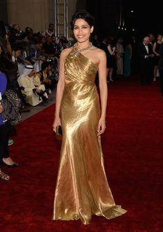 Freida was the golden girl at the Dubai Film Festival in this gorgeous satin gown. Brand: Ralph Lauren