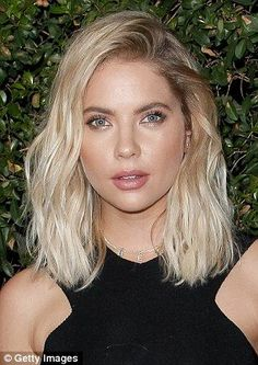 Pinky Little Liars! Ashley Benson debuted her new pink locks while sitting courtside at th...