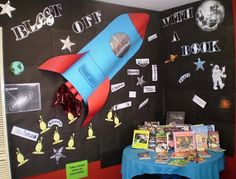 Library Displays: Blast off with a Book. Slightly 3D (...) rocket on a black background. Simple, but the bright colours of the rocket would catch the eye.