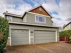 8401 SW 195TH PL   Craftsman with Gorgeous Views on .13 Acres! Large, spacious five bedroom home. Hardwoods, high ceilings throughout, three finished levels. Open concept kitchen with granite, island, walk-in pantry and gas stove! Living room, large picture window with view, gas fire. Two large decks connected by spiral stair. Office on main. Master suite, fireplace, garden tub, double sinks. Plenty of storage! Tons of natural light and stunning views.