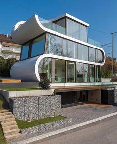 Ultramodern Ribbon Winds Flexhouse in Zurich designed by Evolution Design