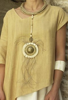 Necklace: pendant made of bone and hammered brass, ethnics beads, rush string and linen string