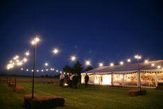 Outdoor festoon lighting for wedding marquee