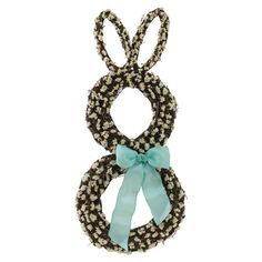 Designed with white sinuata and turquoise satin ribbon in a bunny wreath.   Product: Preserved wreathConstruction M...