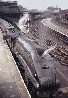 'Union of South Africa' 60009 takes on water at Perth during the halt here,This was the 08:25 off Aberdeen going to Glasgow-Buchanan Street taking about 3 hours for the journey.I rode this train all the way standing next to the window just behind the corridor tender. 1965