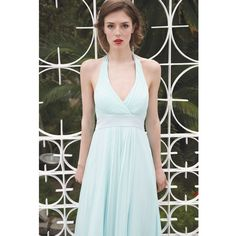 A beautiful full length version of the Dorothea Dress. This halter neck gown features satin contrast ties and a satin contrast waistband and has a flattering pleated panel running through the middle of the dress. Can be worn for any special occasion and is an ideal choice for bridesmaids.         Halter neck style gown        Sits on the knee        Fully lined          Satin waistband        Satin tie detailing          Silk Chiffon fabric        Fabric composition: 100% Silk (Outer layer)…