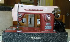 Vintage Morse sewing machine. I have this model but it's blue where this one is pink.