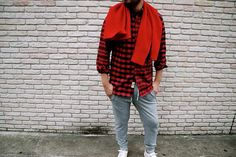 Red scarf, red buffalo plaid shirt, grey sweatpants, white shoes