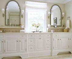 Two white bathroom vanities