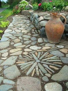 Raised bed surrounded by a beautiful path.  Rock <3