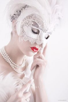 masks - how about having the entire wedding party in masks - kind of a mardi gras wedding, how interesting .. ..