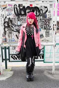 She's wearing a pink leather jacket, eyeball hair bow & Demonia platform boots. Check out all of her pics & info here: http://tokyofashion.com/korn-pink-hair-pink-leather-jacket-demonia-boots-harajuku/